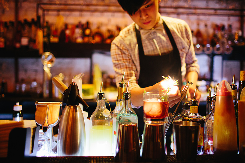 A bartender at work at Maison Ikkoku