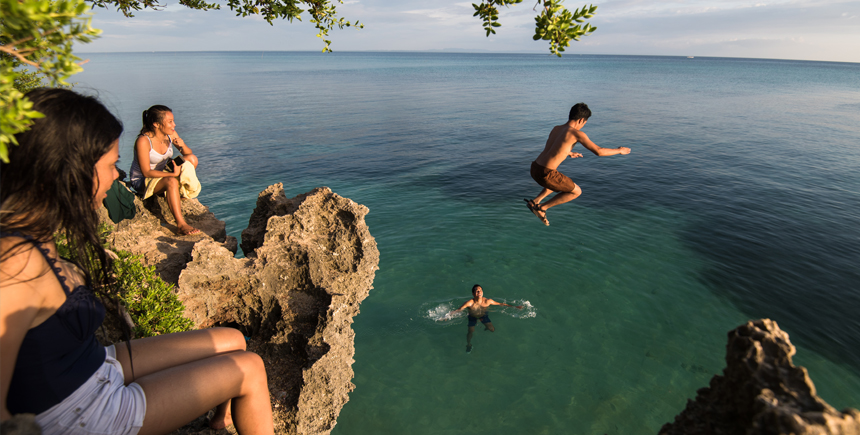 Cliff-diving at sunset Bantayan Cebu