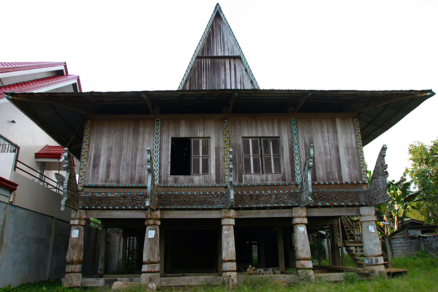 The torogan, or traditional house, with its ornate carvings, is reserved for a datu (leader) and is a display of his wealth and power